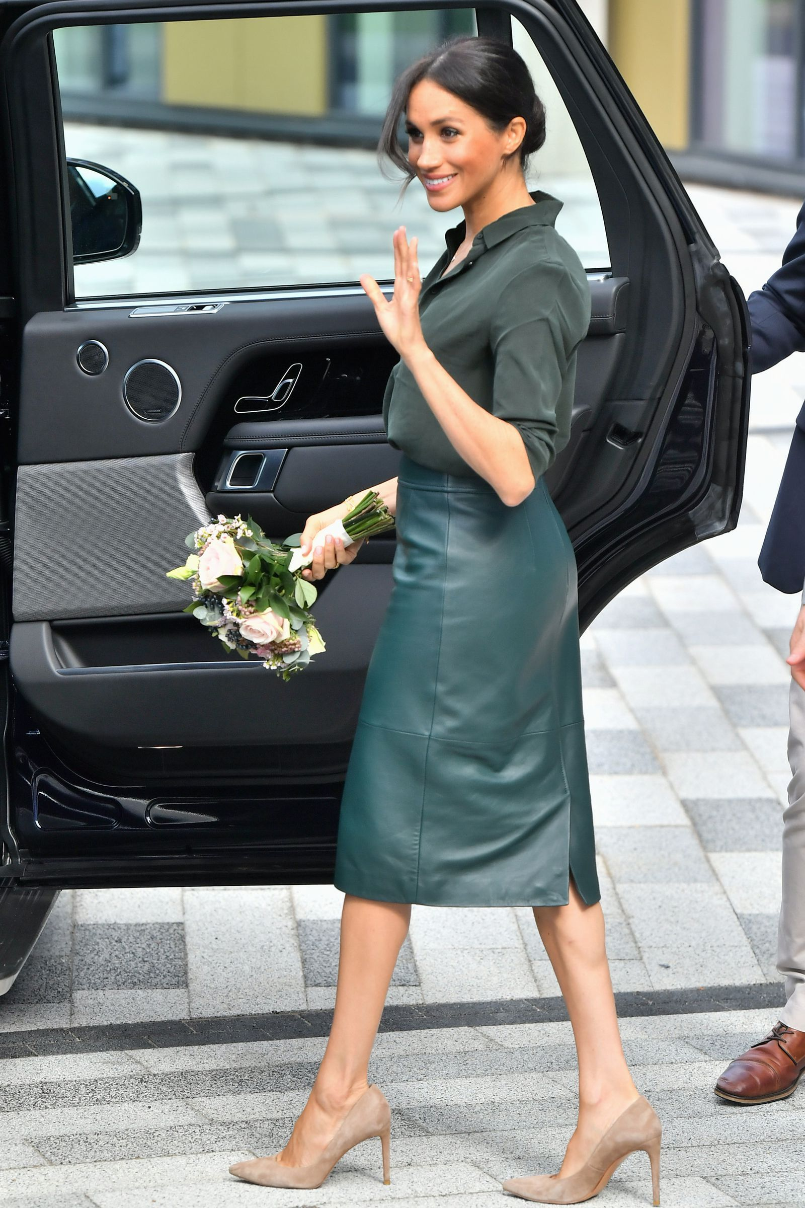 f06c5fa583ec Meghan Markle Just Arrived in Sussex Wearing a Green Leather Pencil Skirt-  TownandCountrymag.com