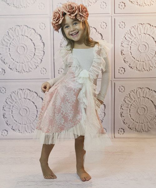 This fluttery pair is fit for a fairy! The ruffle-rich overlay is so light and breezy that little ladies will feel like they're dancing on air, while the soft, sleek layer underneath keeps them grounded.