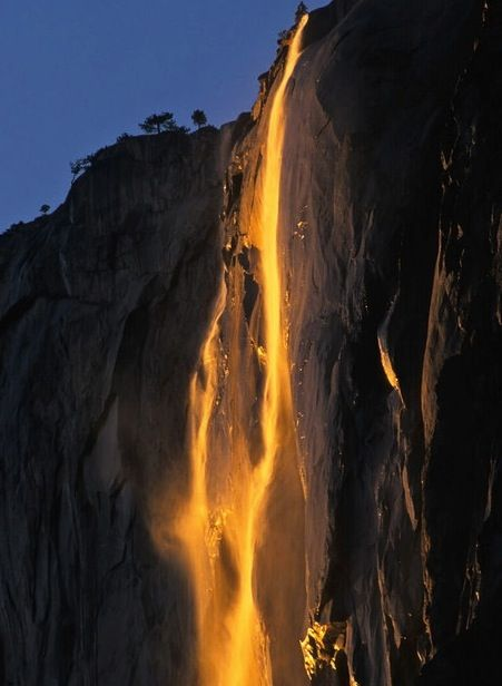 Yosemite Golden Horsetail Fall-  As the sun sinks low in the sky, the waterfall glows with streaks of gold and yellow