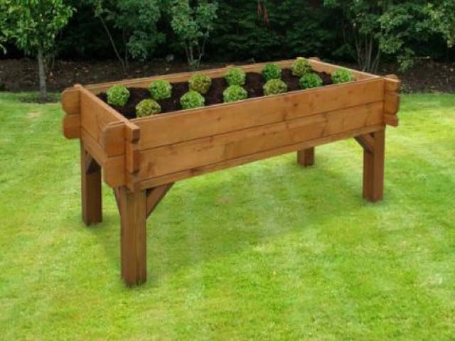 The vegi table raised table shaped ve able planter