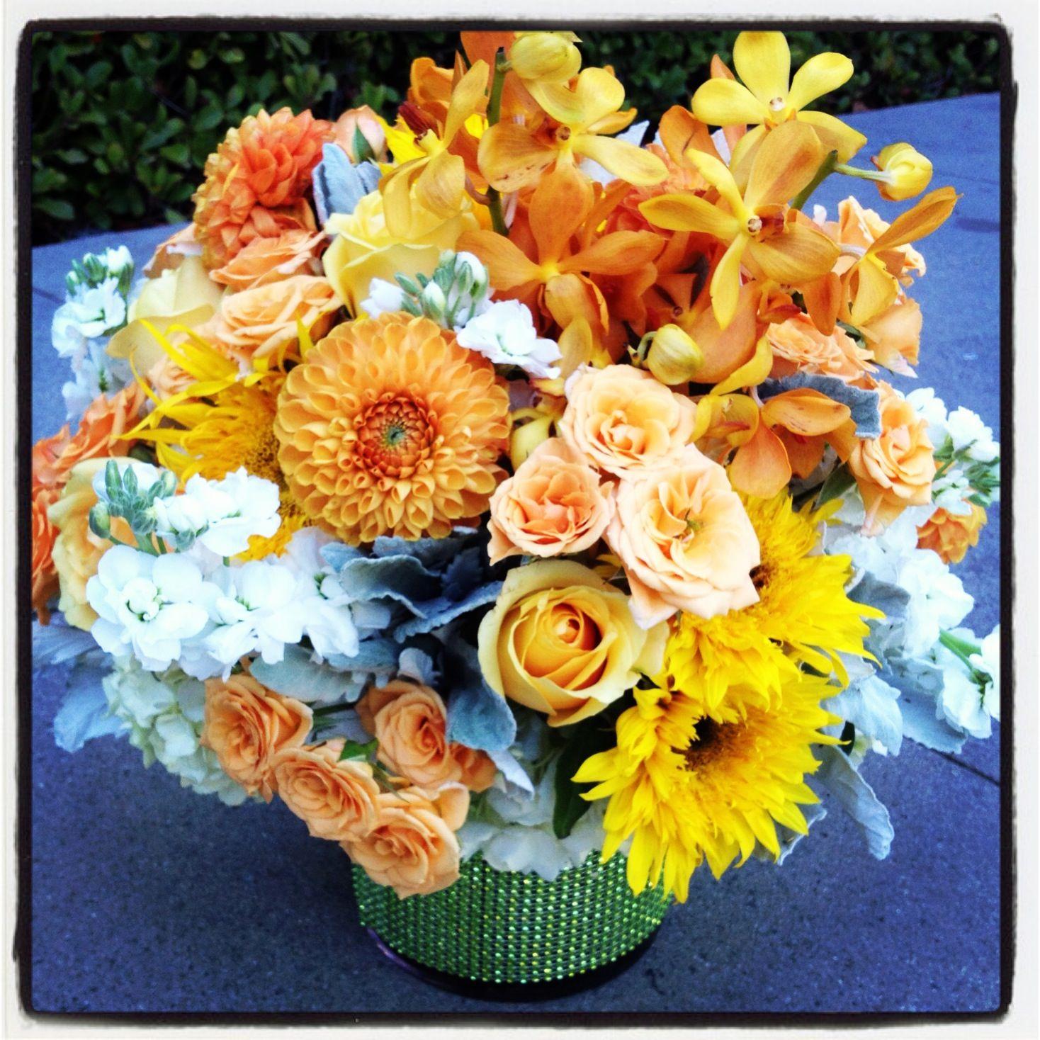 "Summer arrangement!  With all my favorites rose, dahlias, ""Teddy Bear"" sunflowers, Singapore dendrobiums, hydrangea & stock."