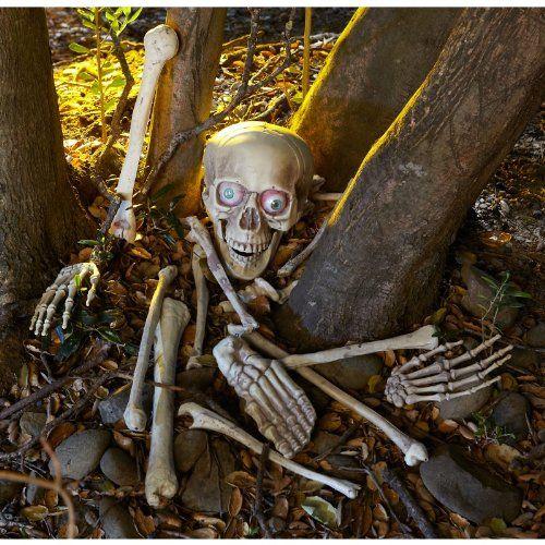 Skelett Gebeine Totenschädel mit Leuchtaugen, Sound und Bewegungsmelder 18 teiliges Horror