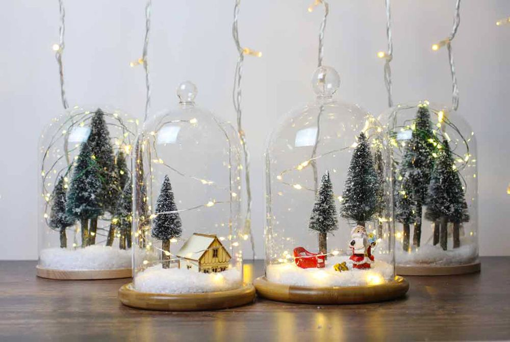 Christmas Terrariums With Different Decorations In The Stylish