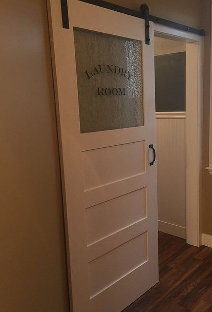 the finishing touch a sliding barn door for the laundry room, diy