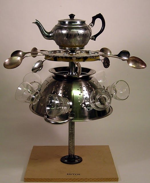 Vintage teapot with colander and spoons teapot.