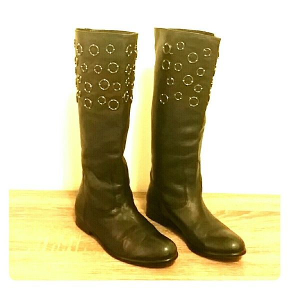 Barneys New York Black Boots Beautiful authentic leather black boots with metal ring details on the top. It's is good condition, I've only wore them a few times. Only 1 ring has came loose, but it can be asily fixed. Barneys New York CO-OP Shoes Winter & Rain Boots