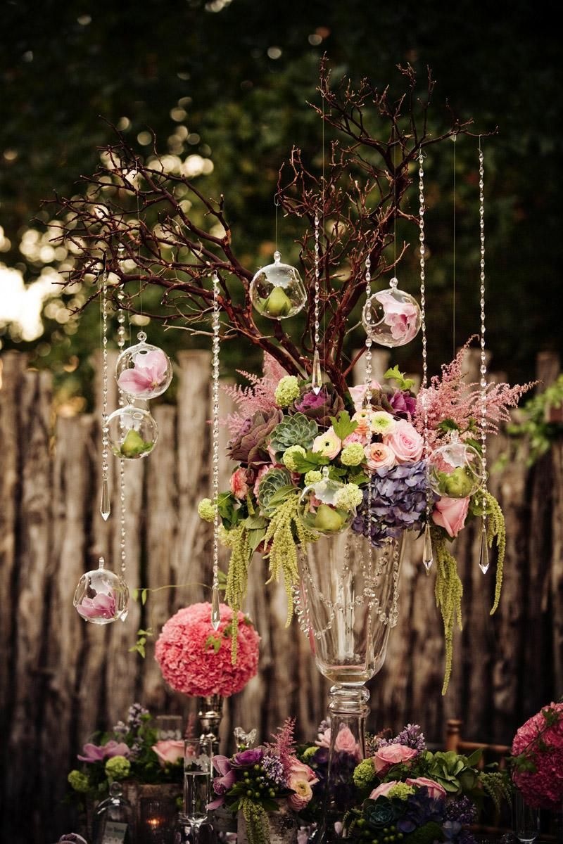 Wedding decorations hanging from trees  Love the tall tree Branch and have flowers hanging off of them