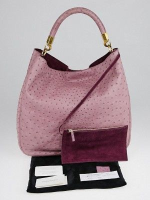 d840b27f7aa4 This gorgeous Yves Saint Laurent Light Purple Ostrich Roady Bag is  functional yet fun and edgy. It features a sleek design with stunning  ostrich skin ...