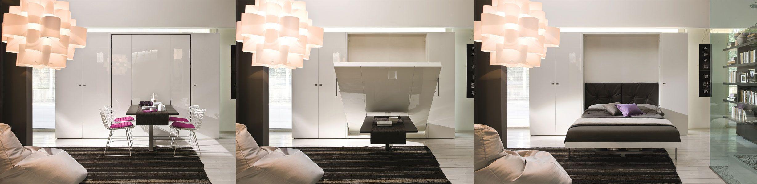 <strong>Cama e mesa:</strong> na configuração do dia, dispõe de uma mesa para quatro a cinco lugares. Ao abrir a cama de casal, a mesa fica sob a base que sustenta o colchão. Esse móvel da Linha Ulisse Dining é da Mobili Intelligenti.