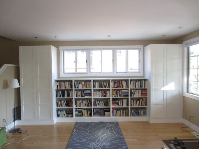 IKEA Hackers: Living room built-in bookshelves and closets using BESTA shelves and PAX wardrobes
