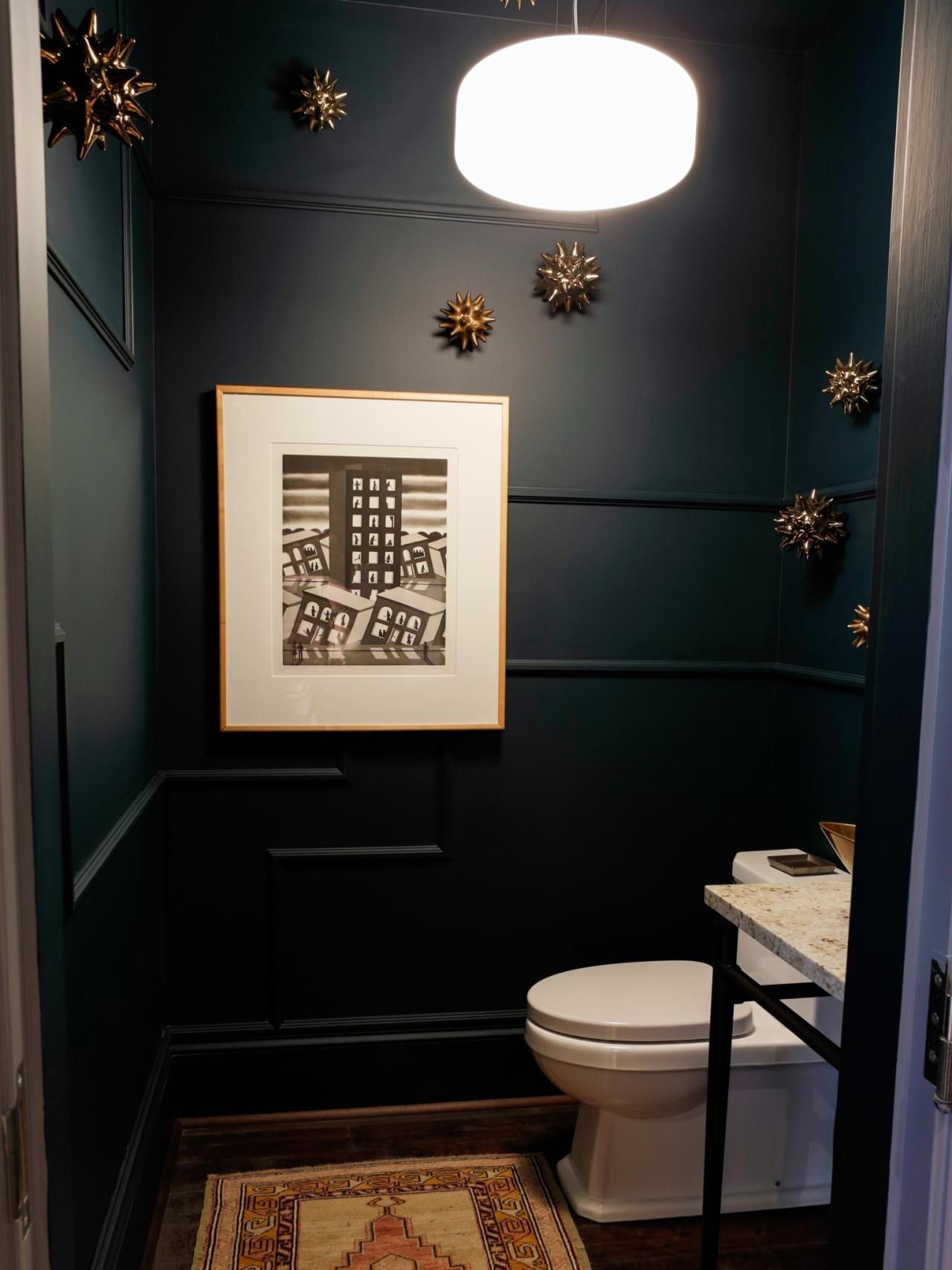 This stunning powder room gets its contemporary look from a mix of