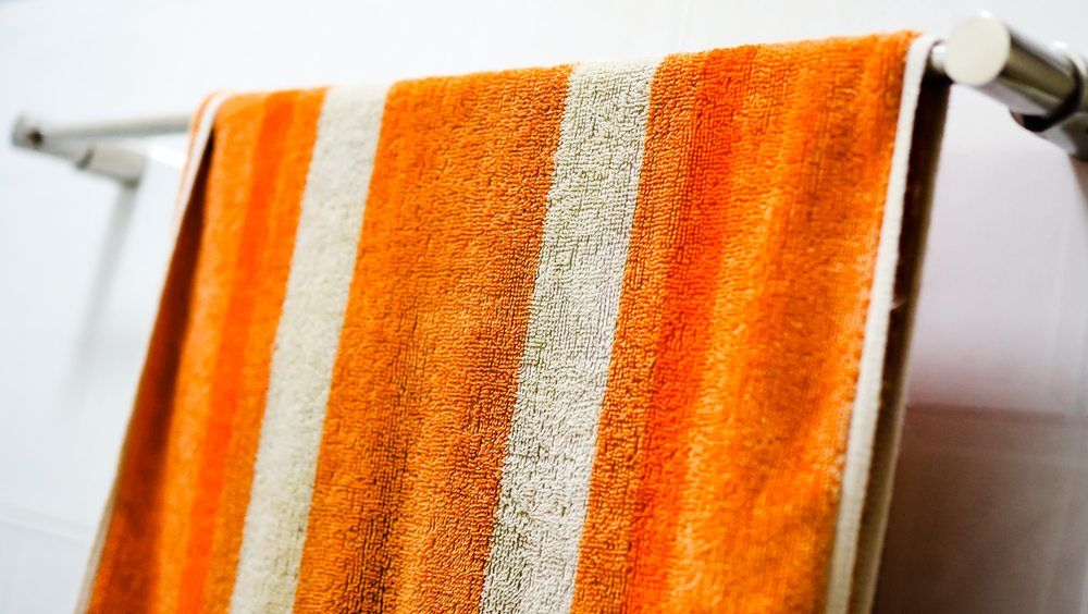 How Often You Should Wash Your Bath Towel According To A