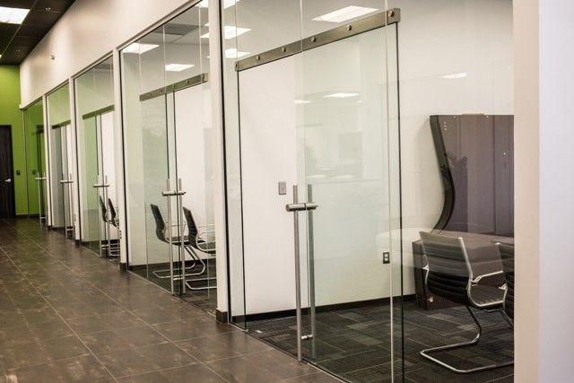 Unik air glass transom barn door interior frameless for Commercial interior sliding doors