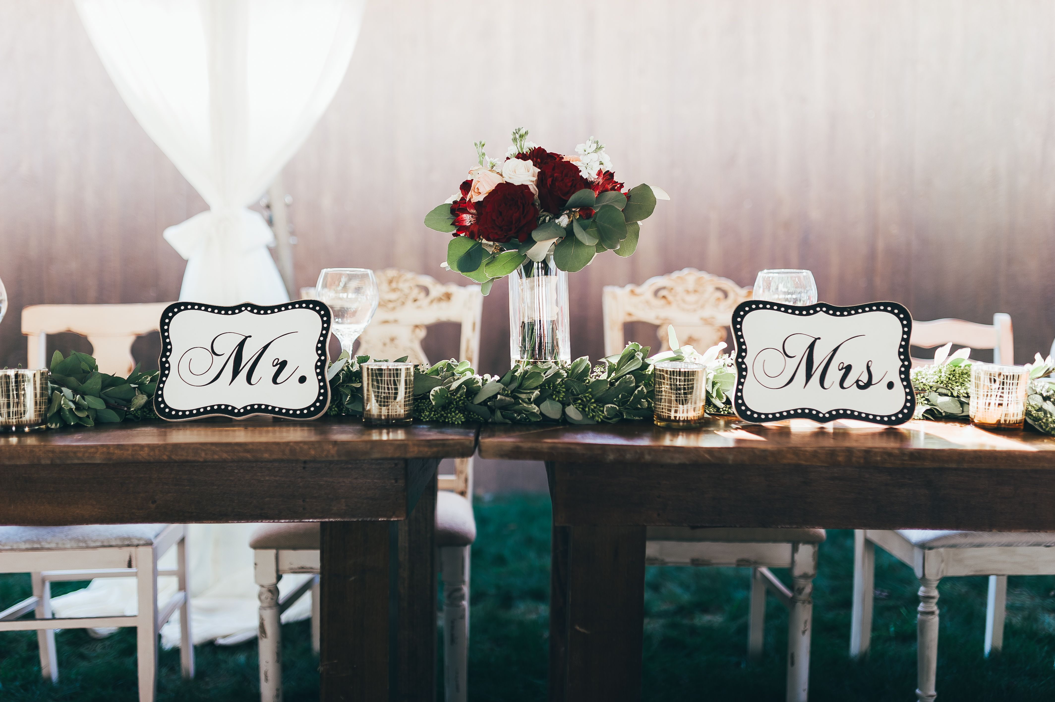 Head table for wedding party. Farm tables and mix matched