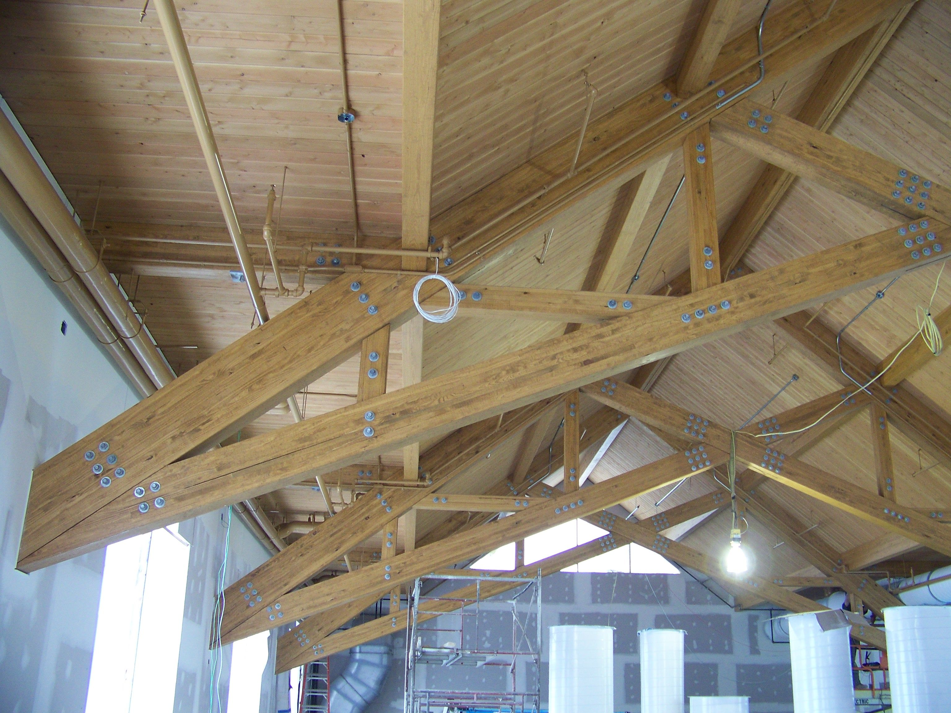 Some Of Our Glulam Trusses In The Colgate Fitness Center Before The Building Was Finished Timber Architecture Timber Frame Ceiling Lights