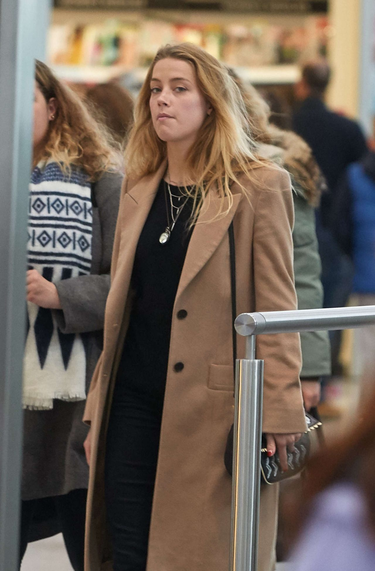 b6d93aeb40 Amber Heard – Heathrow Airport in London – March 2015