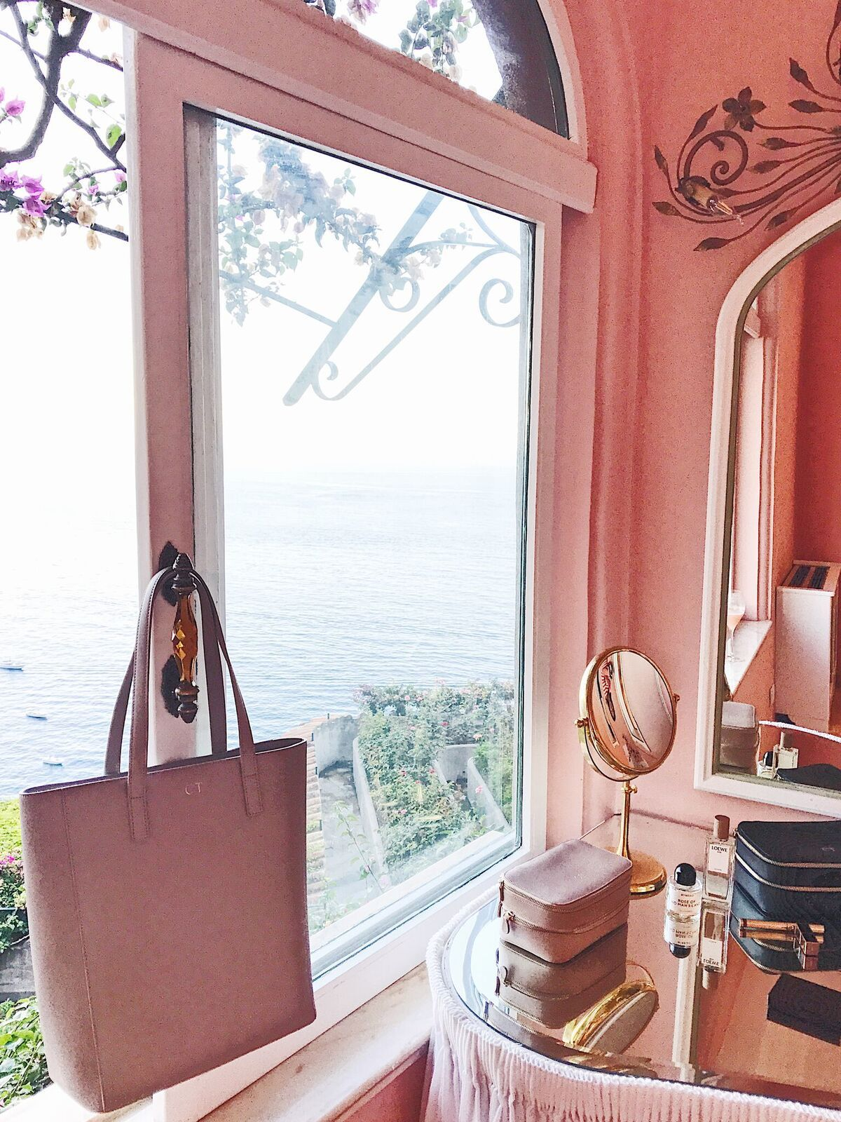 tde square tote looking stunning in the blush pink hotel room in amalfi the square tote is the perfect bag for exploring italy fits everything you might