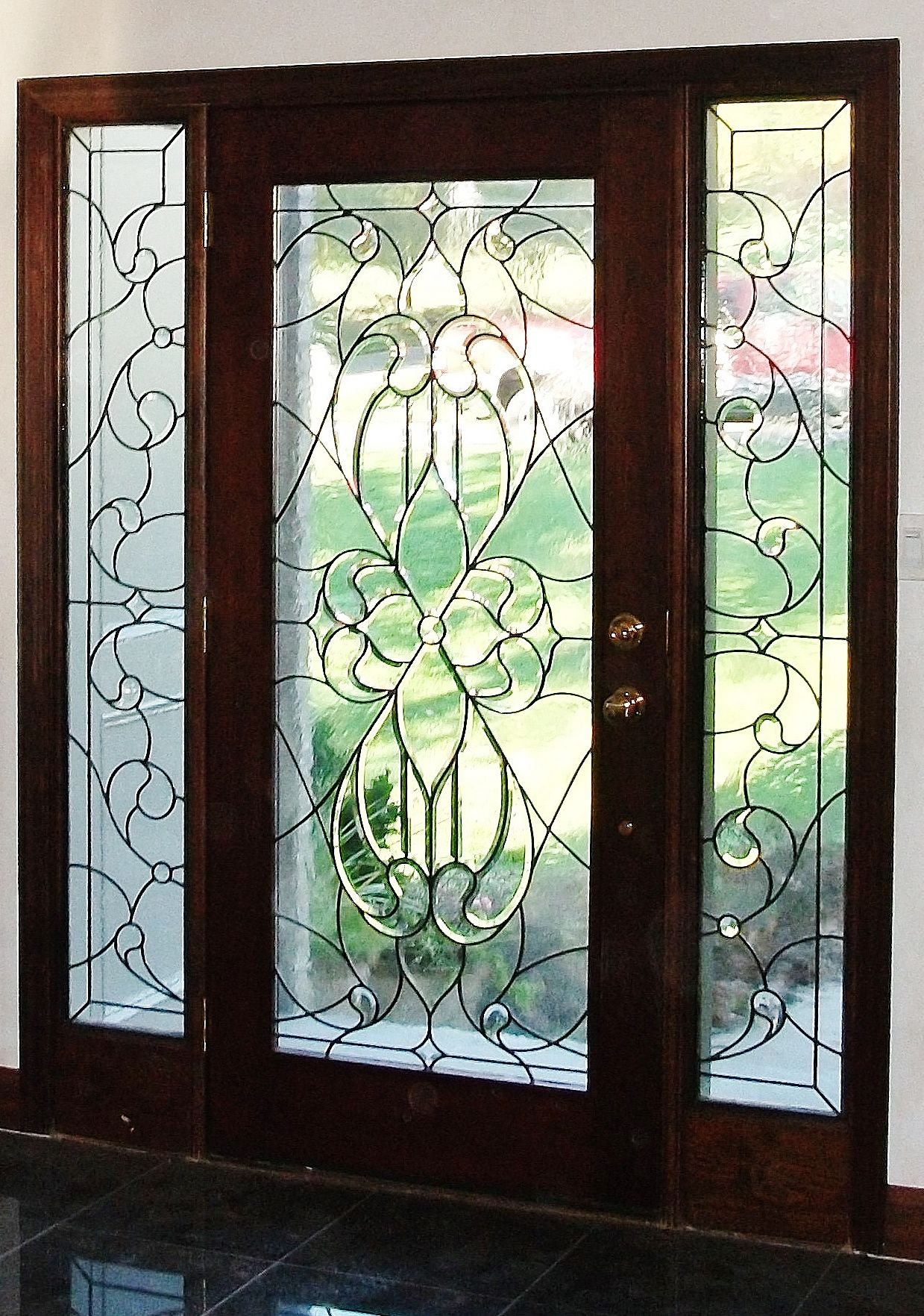 Custom stained leaded glass designed furnished and