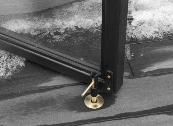 Custom bronze hold-open on an exterior door by Face Design +…