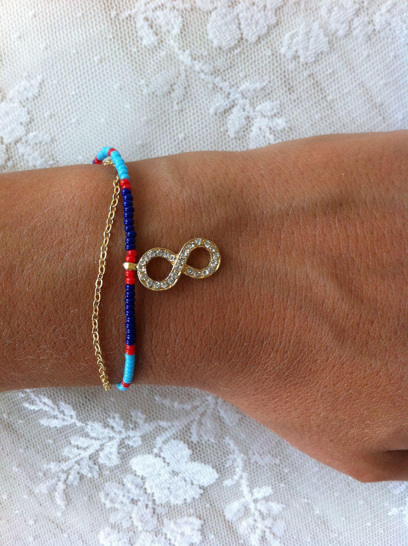 Reserved infinity bracelet with blue bead friendship bracelet