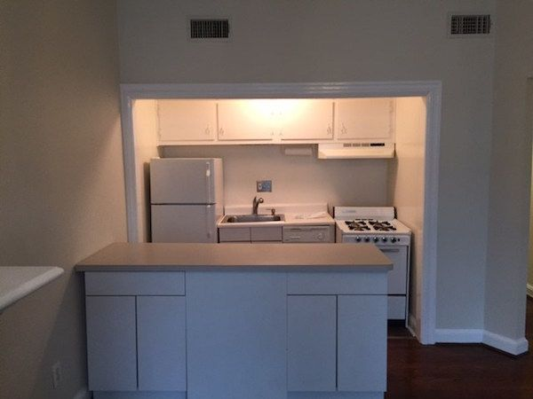 How To Reface Kitchen Cabinets Using Vinyl Flooring Refacing Kitchen Cabinets Contact Paper Kitchen Cabinets Vinyl Flooring