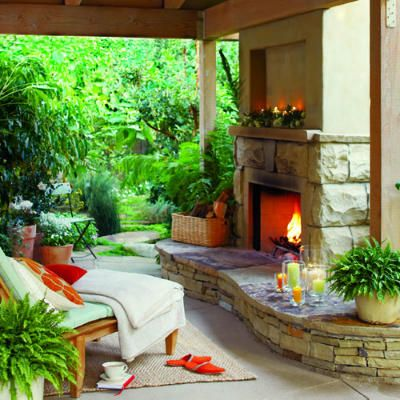 40 patio ideas. This one is my fave... The outdoor fireplace with a cozy throw and a glass of wine.
