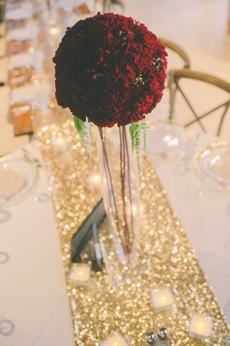 Flower ball centerpieces on tall glass vases goldwedding