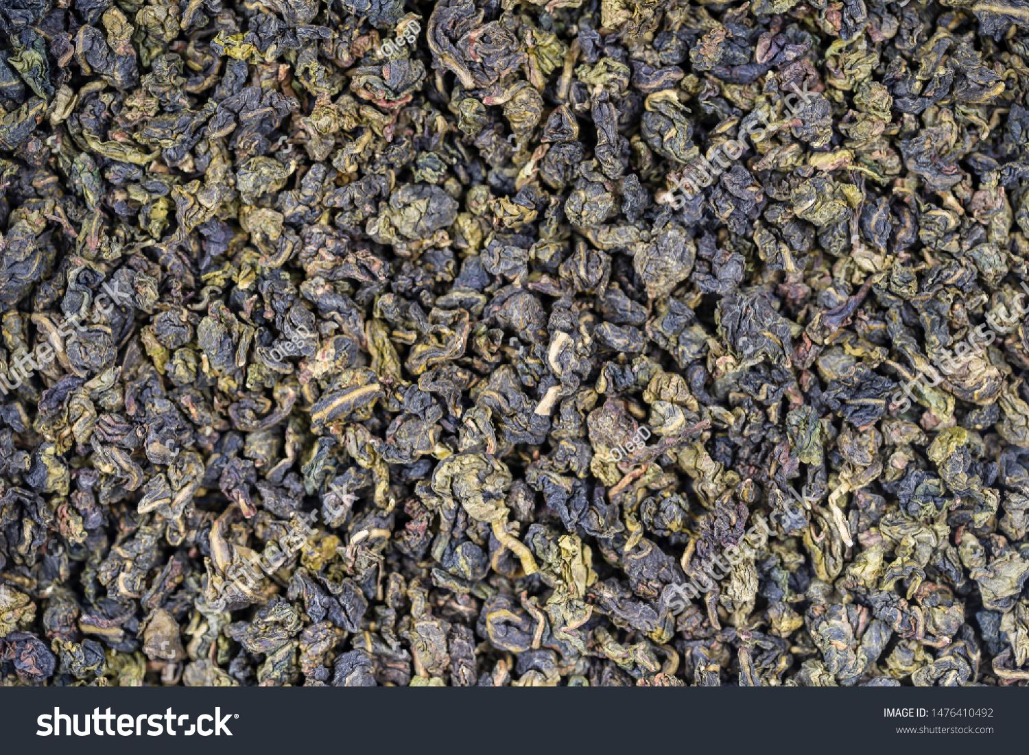 Green tea leaves background Oolong tea Abstract food textures Close up top view