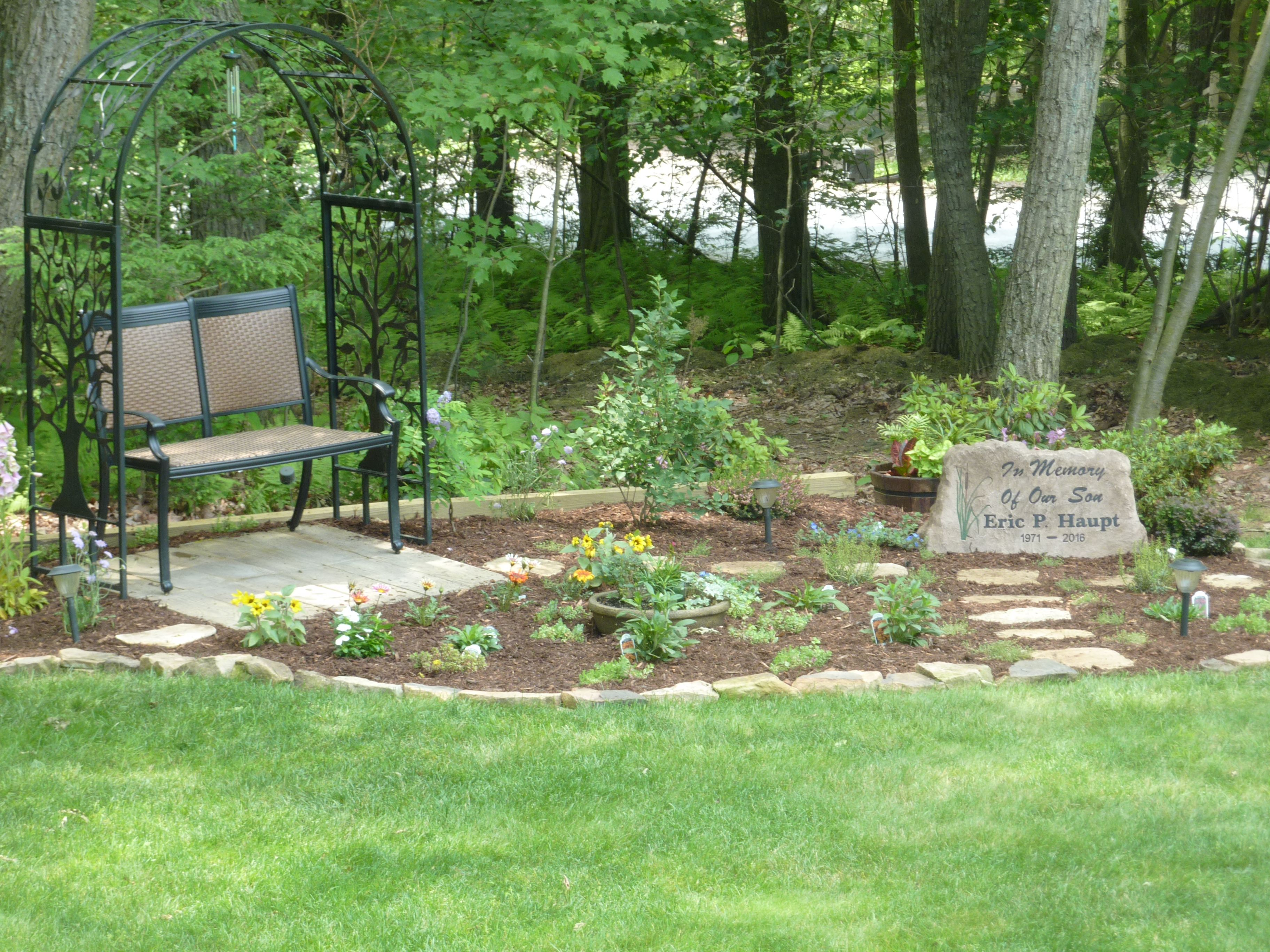 our memorial garden for our son featuring a custom made stone