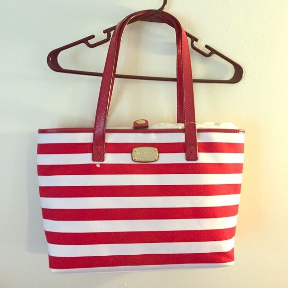 Michael Kors Bag red/white Summer Stripe NWT Authentic Michael Kors red and white summer striped canvas tote. Handles are vinyl. Small packet on back. Inside has a zippered pocket and 4 additional pockets for cell phone etc. new with tags! Michael Kors Bags Shoulder Bags