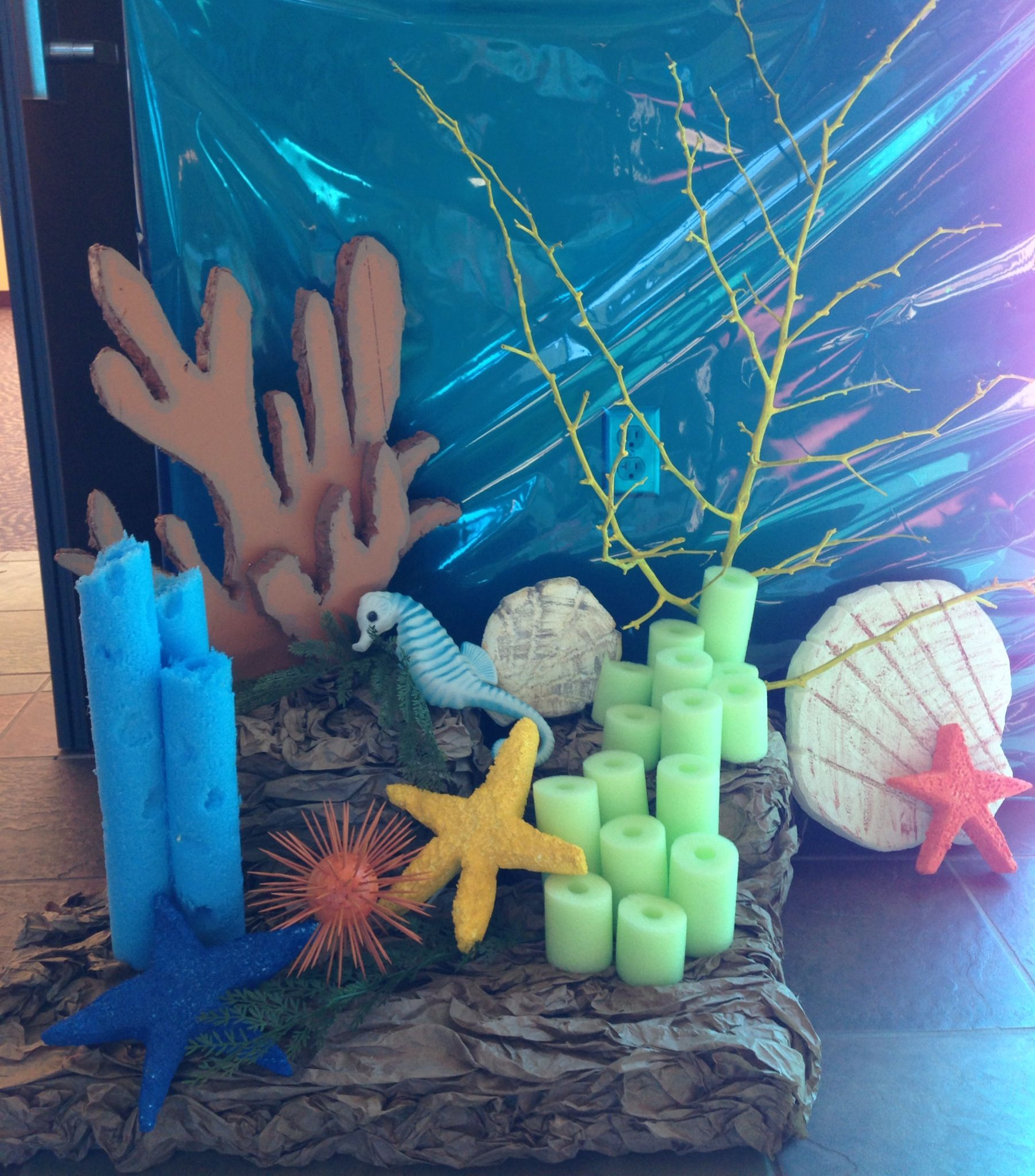 Pool noodles this scene is a little too under the sea for Ocean decor ideas