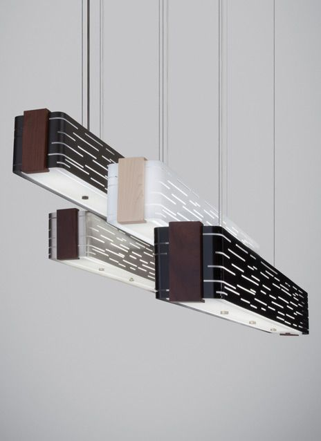This dramatic linear suspension fixture captures light in motion.