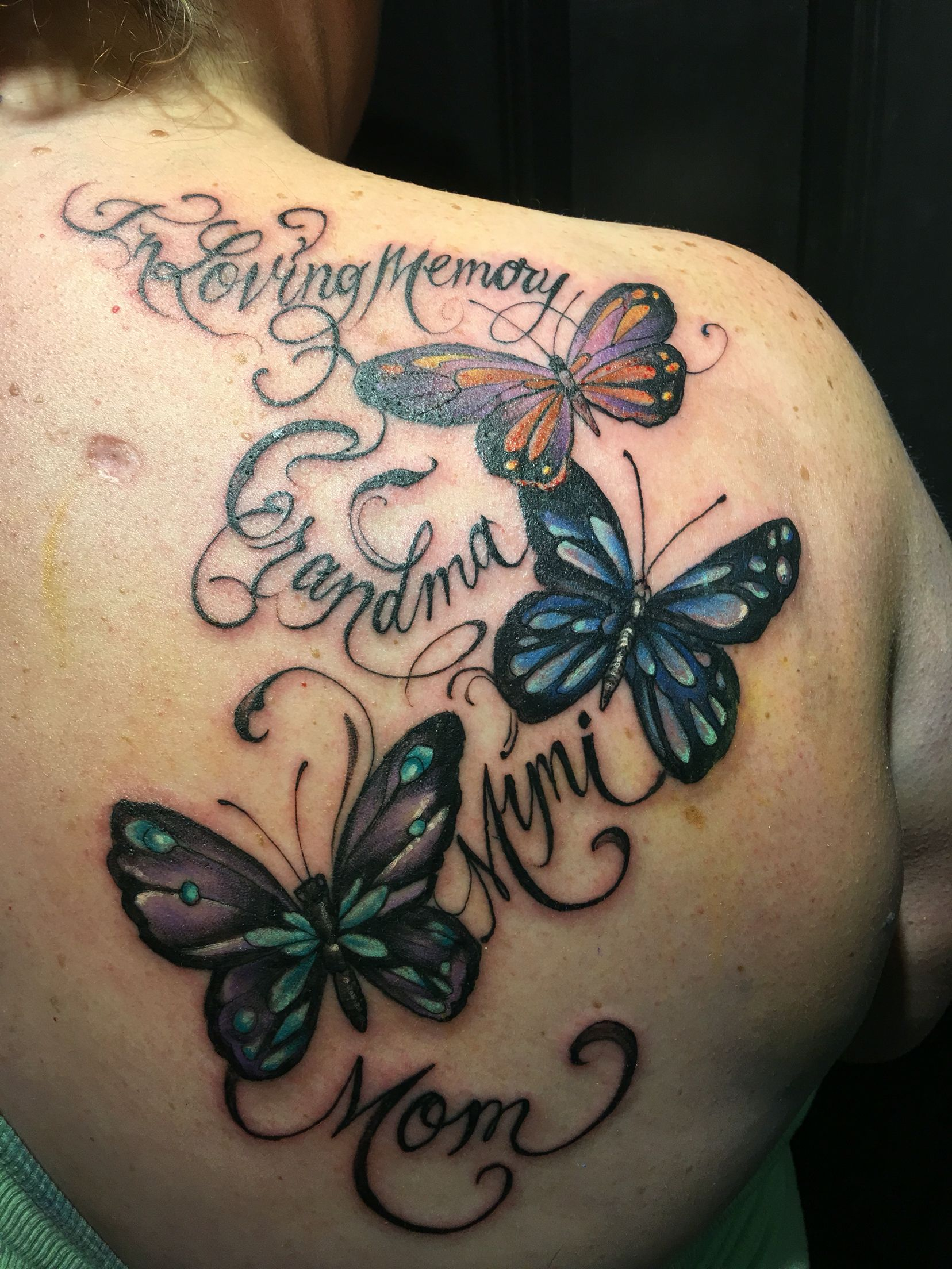 Beautiful butterfly tattoo in memory Name tattoo designs