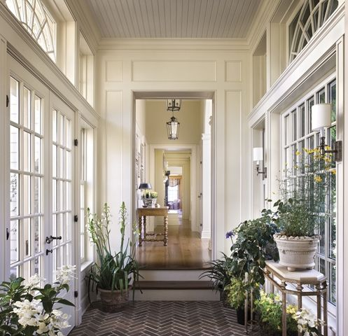 Herringbone brick floored garden room/entry with french doors, and