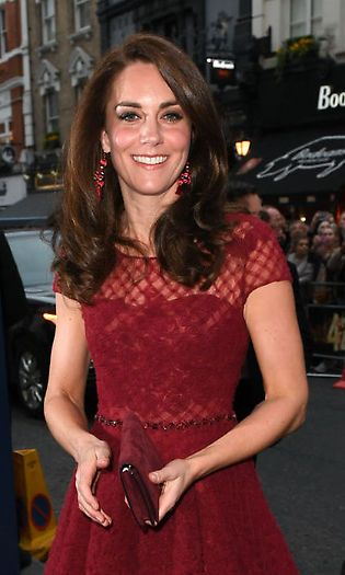 Kate stunned in red wearing her long hair down in loose curls Photo: © PA