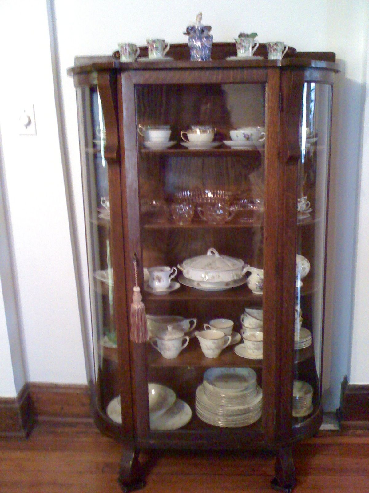 My great-grandmother Brubaker's antique oak curved glass china cabinet with  my eclectic china collection - Curved Glass Antique China Cabinet Antique Furniture