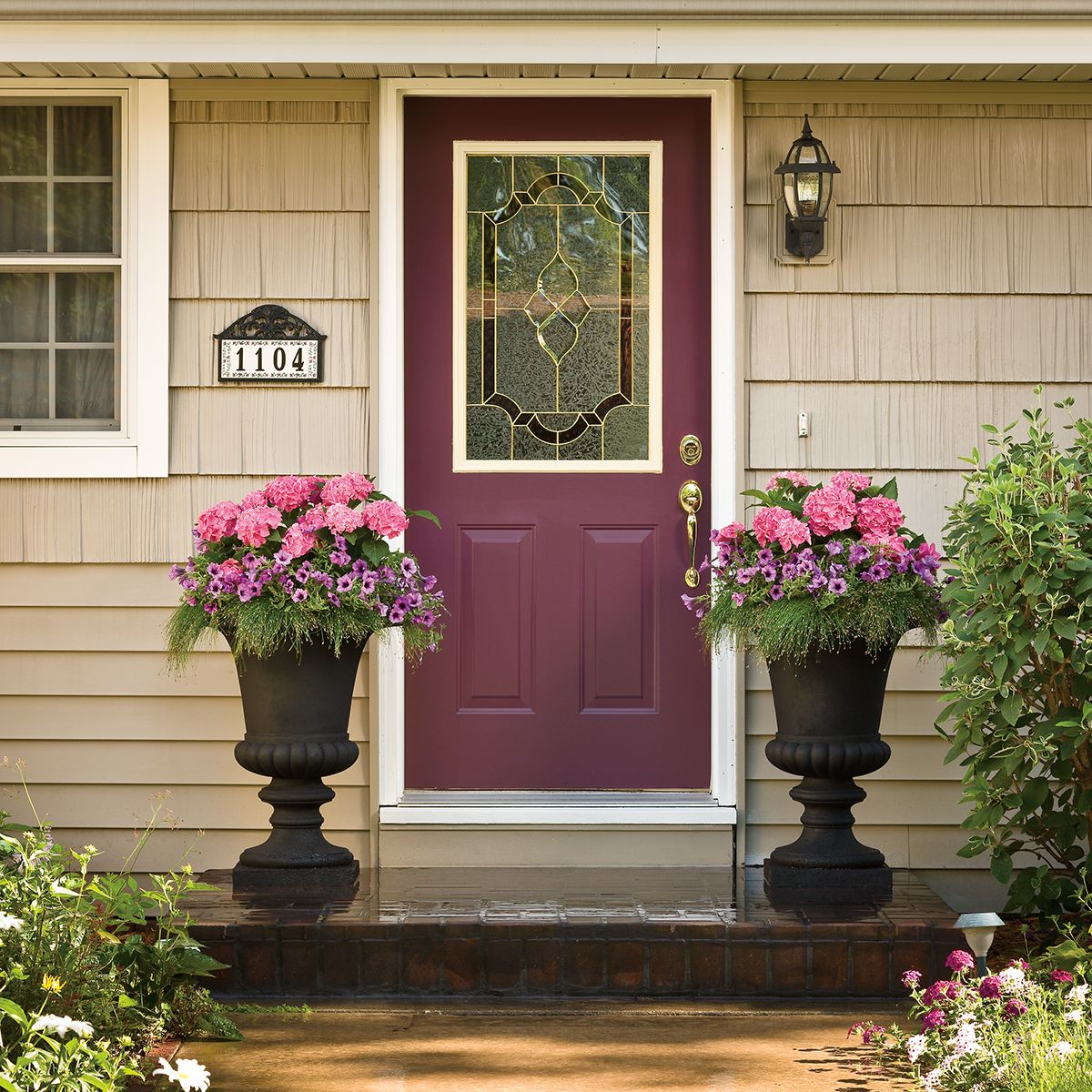 By Using Large Urns That Can Hold A Lot Of Soil It Opens Up The Possibilities To Growing Large Front Door Plants Patio Container Gardening Potted Plants Patio