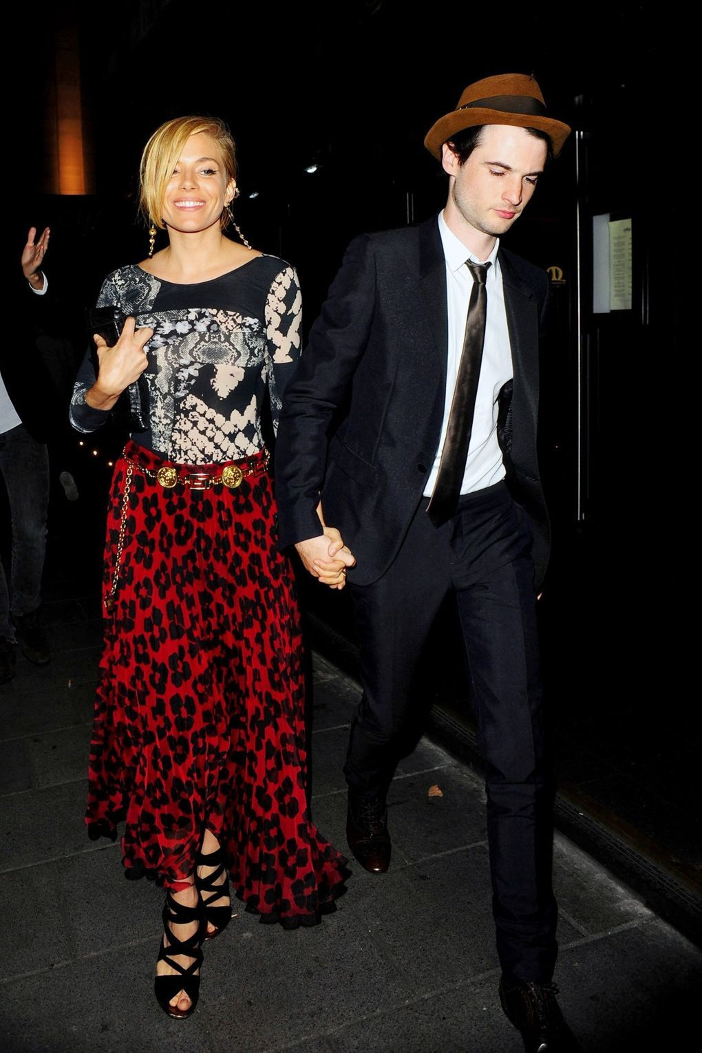 Miller wore an animal-print top and skirt with a side-swept, short hairstyle for dinner at J Sheekey in London.