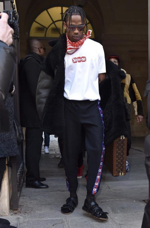 e904c489dc2 Travis Scott Wears Louis Vuitton x Supreme During Louis Vuitton Paris  Fashion Week Show
