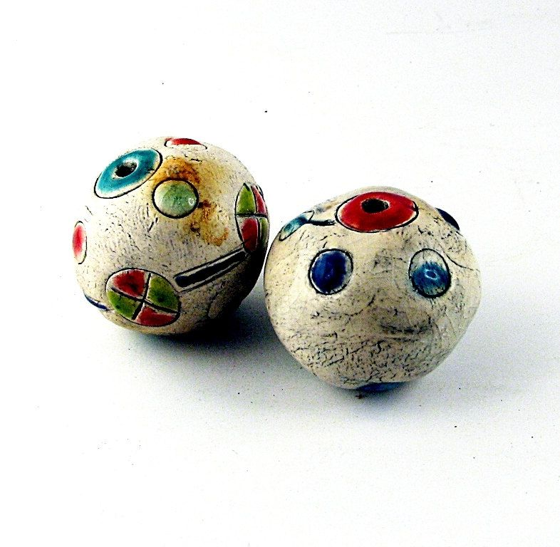 Consuming complexity -- Afghan kuchi inspired large, bright, hollow, antique-looking ceramic beads.  via Etsy.