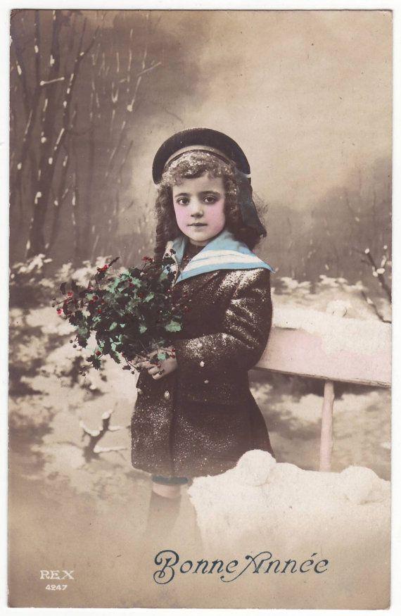 French postcard Little girl in the snow door EphemeraUniversalis