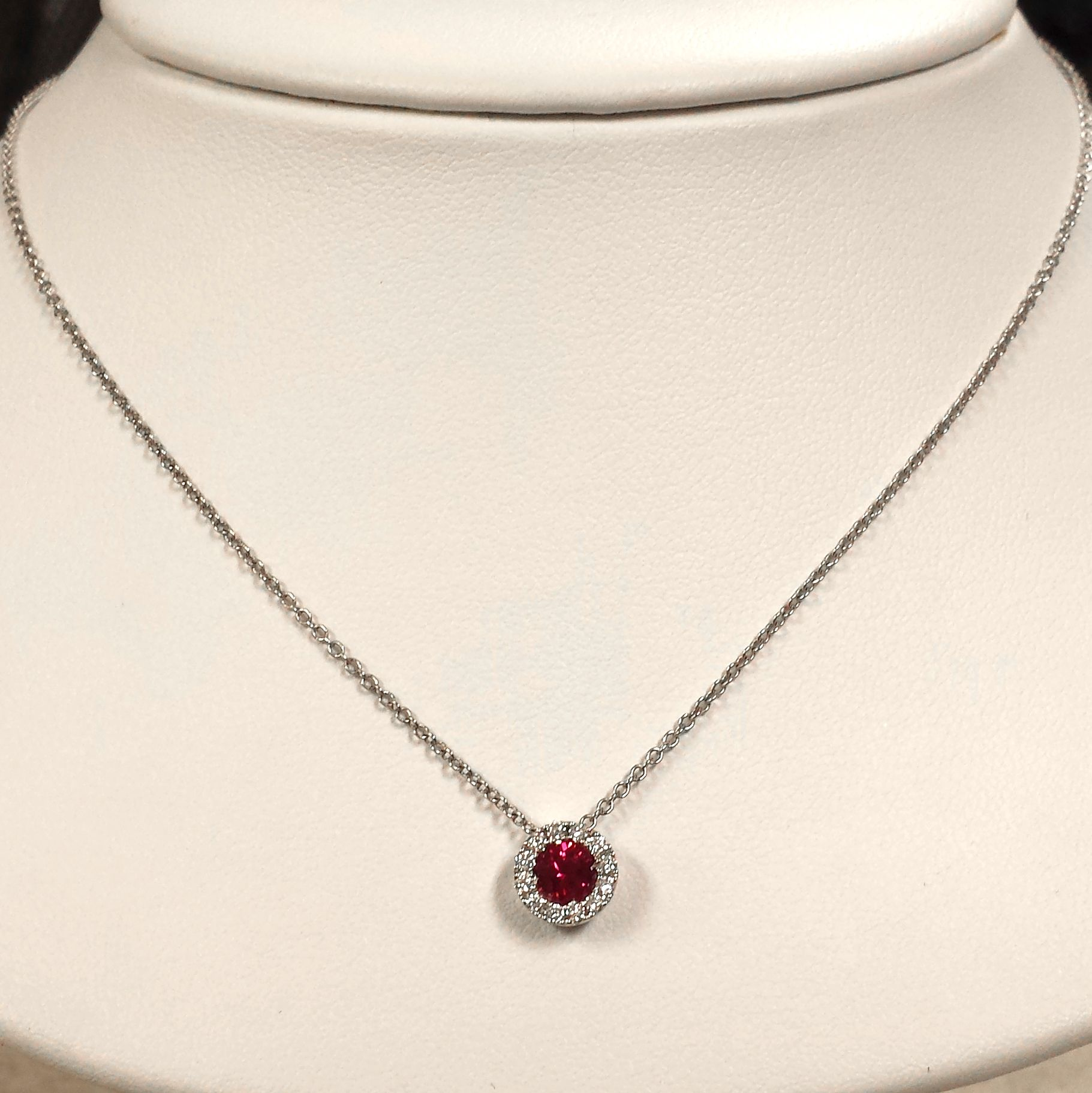 Gorgeous ruby and diamond halo pendant set in white gold perfect