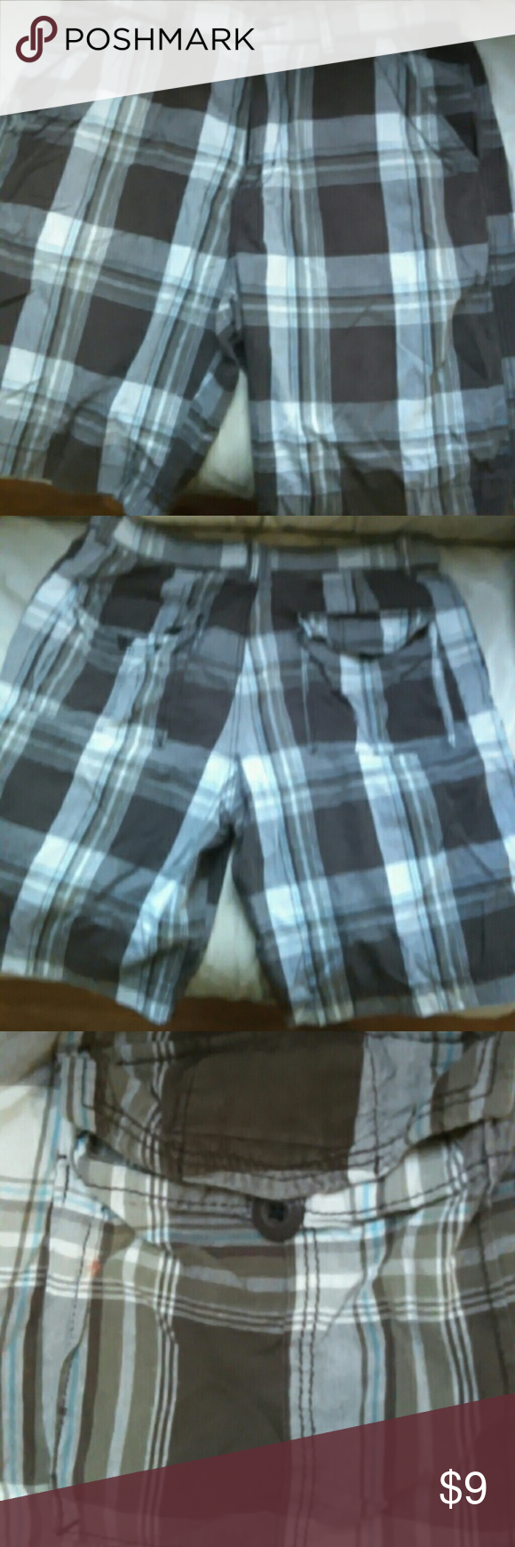 Men's plaid shorts size 34 These sorts are mostly brown and white with one blue line in the plaid. Tiny bleach spot near back pocket in picture. Bundle two or more items and save $15! UNIONBAY Shorts Flat Front