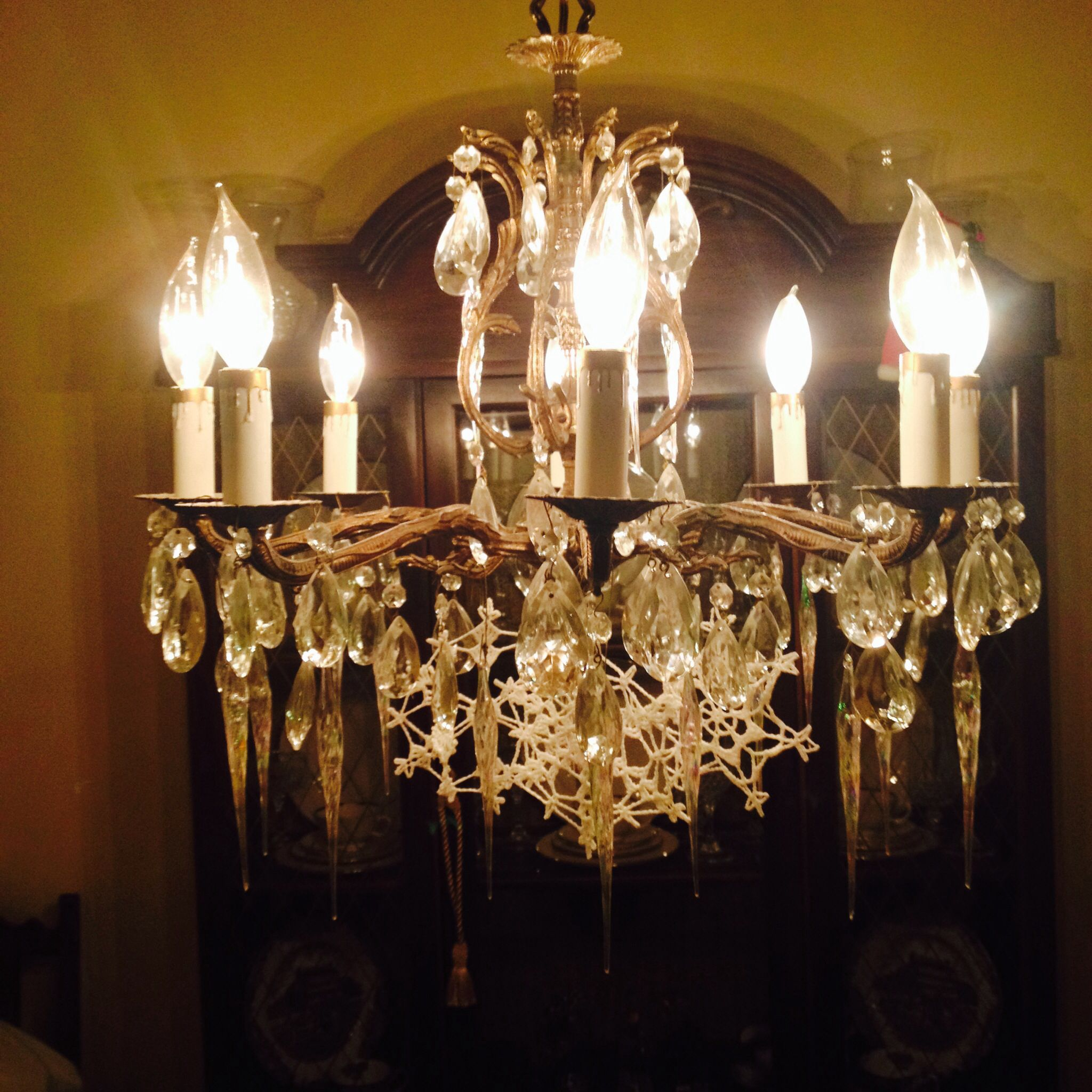 My mother's chandelier for Christmas, hanging icicles and snowflakes!