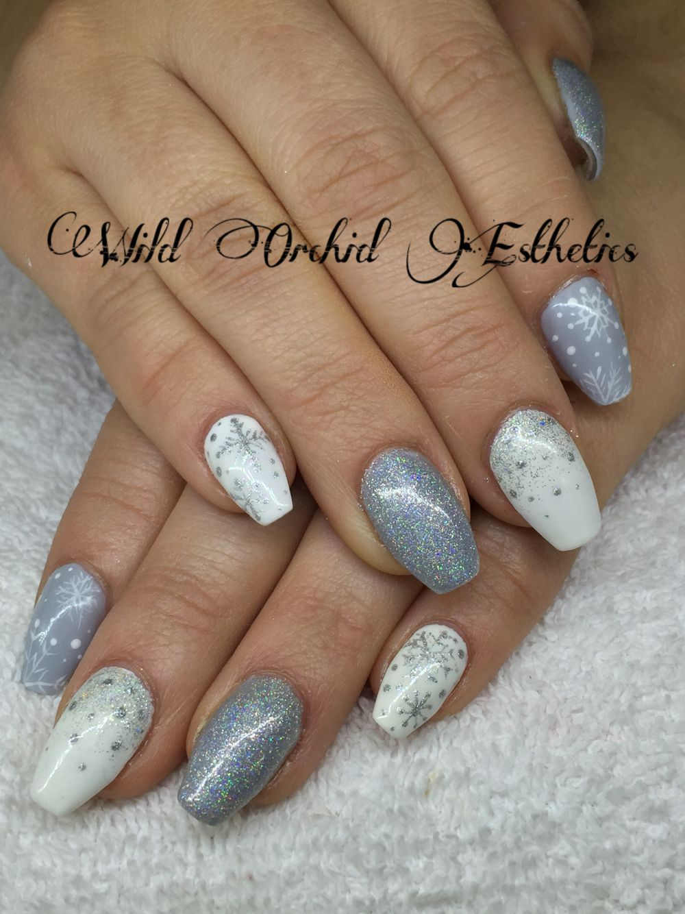 Silver and white snowflake gel nails. Glitter. Ballerina nails. Hand ...