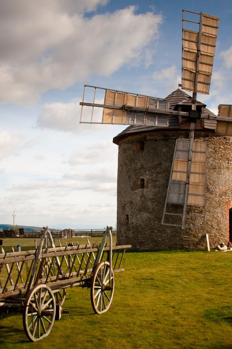 Free download of this photo: https://www.pexels.com/photo/wooden-windmill-near-wooden-carriage-during-daytime-161889/ #landscape #field #countryside
