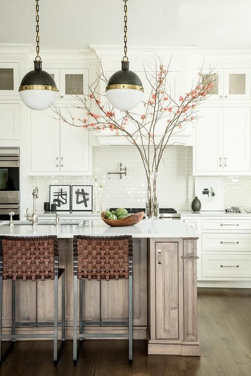 three small hicks pendants illuminates a walnut stained kitchen rh pinterest com