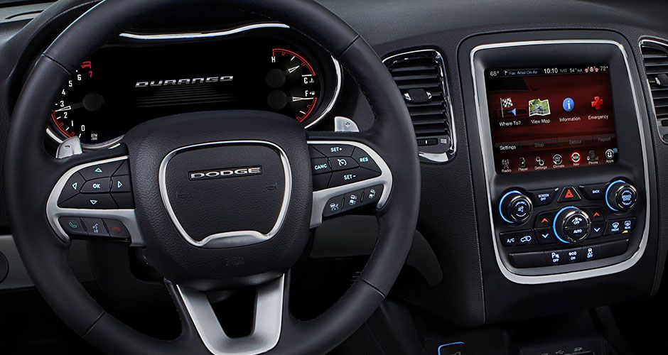 Lovely Interior On The 2015 Dodge Durango. Notice The Steering Wheel Controls And  The Center Console