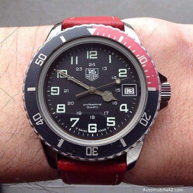 TAG Heuer 1000 Submariner Man black dial on a red leather ...