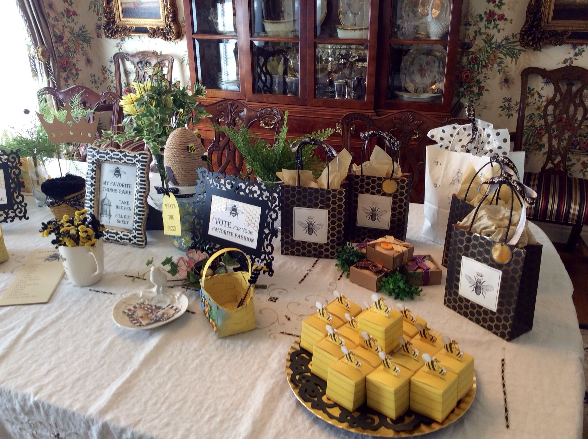 Dining room table set up with games, prizes and favors for Queen Bee, My Favorite Things Party.